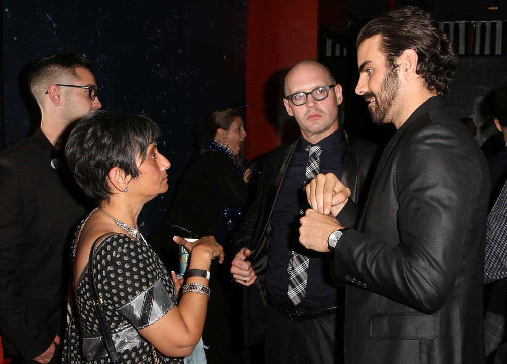 LOS ANGELES, CA - NOVEMBER 29: Kavita Papalia of Sprint Accessibility, a Friends of Nyle sponsor, talks with Nyle DiMarco and Ramon Norrod during Evening with Nyle DiMarco at the Sofitel Los Angeles At Beverly Hills on November 29, 2016 in Los Angeles, California.  (Photo by Tasia Wells/WireImage)